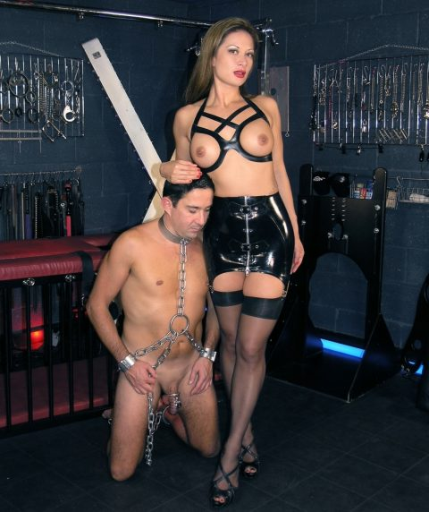 Mistress Jasmine In Hot Latex Skirt and Chastity Submissive