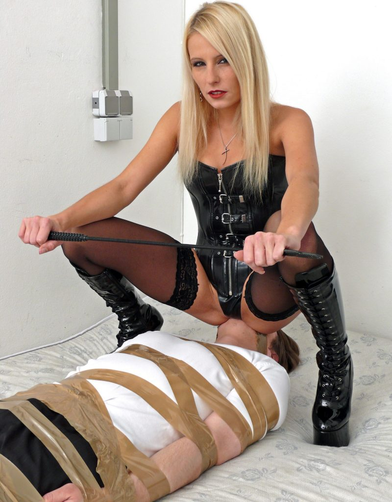German Mistress Melissa In Latex Clothing and Stockings - Facesitting Femdom