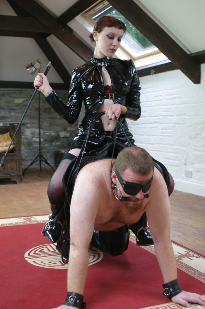Mistress in Fetish Leather Uses Her Slave Like a Pony For Ridding
