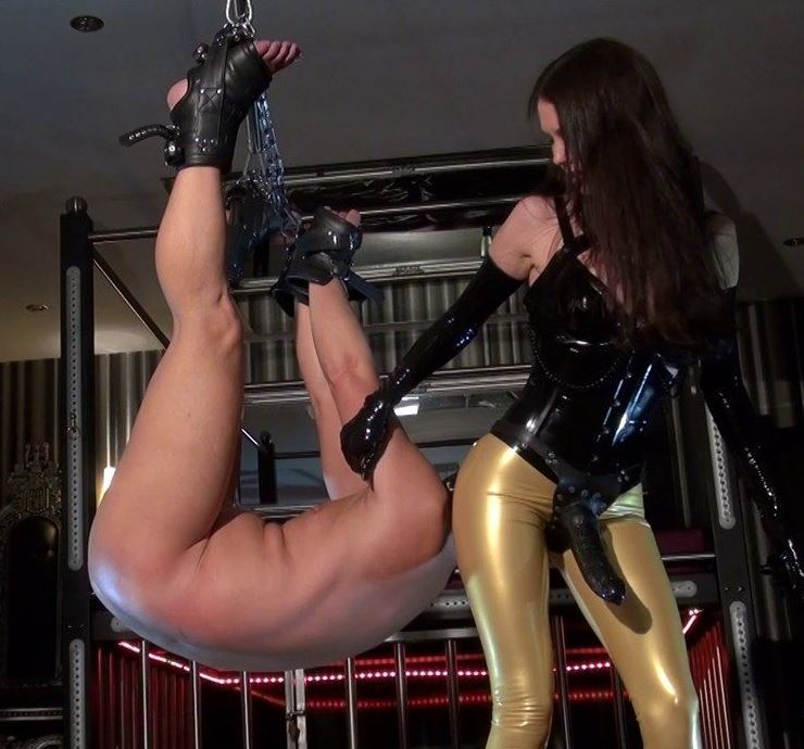 Sexy Strapon Mistress in Latex Leggings Makes Suspended Slave Worship Her Ass