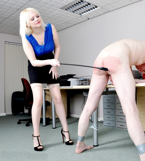 Slave's Ass Turns Red From Being Spanked By Mistress Heather
