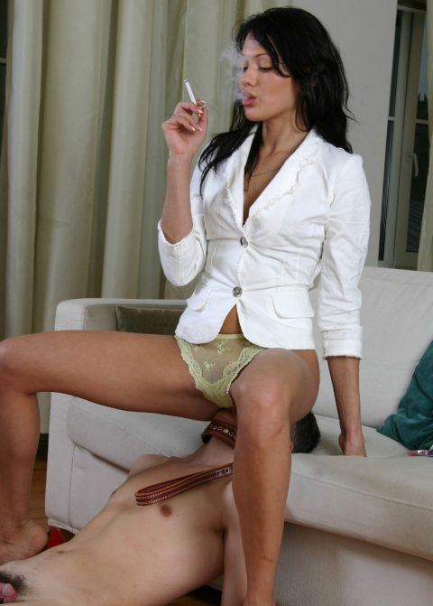 Brunette Mistress Anna In Green Panty Facesitting On Thin Young Slave and Smokes