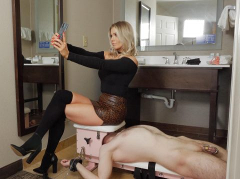 Princess Amber Takes A Selfie Ignoring The Torment Of The Chastitys Slave On Whose Face She Sits - BDSM Human Chair Femdom